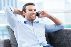 Man sitting in office talking on phone