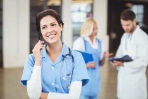 Nurse talking on mobile phone using failover phone system