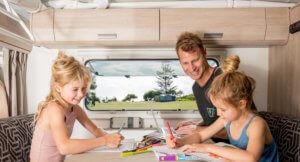 Dad and kids in caravan using cel-fi go